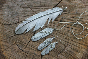 Silver and peridot feather set with earrings and necklaces