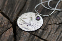 Hand Stamped Pyramid with amethyst gemstone on silver disc pendant