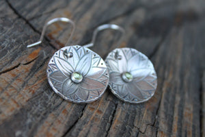 Silver disc earrings with lotus and peridot