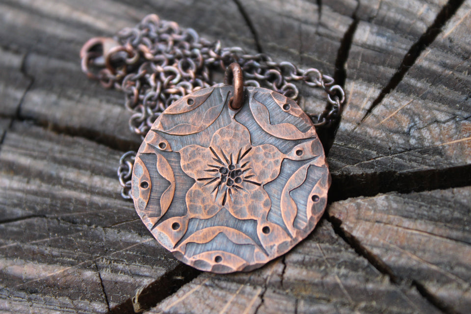 Hibiscus on copper disc necklace