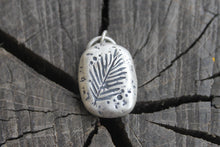 Load image into Gallery viewer, Palm Leaf Stamped onto silver river rock charm