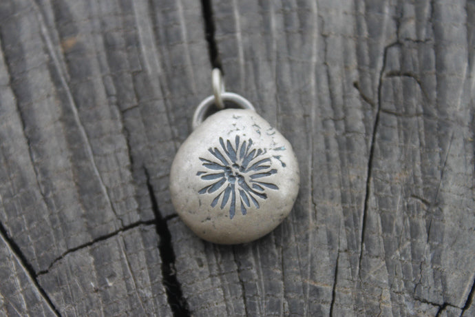 Aster Daisy on silver river rock charm