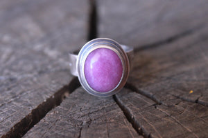 flower of life on ring with pink stone