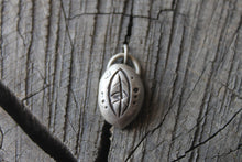 Load image into Gallery viewer, leaf stamped on river rock shaped silver charm