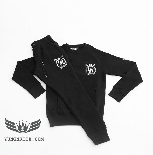 YUNG'N'RICH | CREW NECK BLACK SLIMFIT WOMENS TRACKSUIT.     Yungnrich combines sporty looks with sophisticated style successfully bringing a sense of luxury to our recreational wear. Only Available exclusively at Yungnrich, we present our sweatsuit which comes in a Black colour way. Features cotton construction, ribbed crew neck & cuffs, tonal Stay luxurious on the go in our full slim fit tracksuit . Yung'n'Rich branding on left of chest & leg.