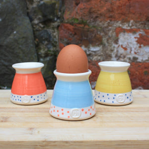 Mustard egg cup, with navy dots
