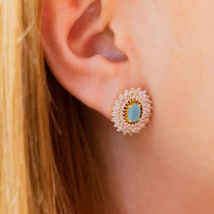 Woman with Earrings with zirconia and blue crystals
