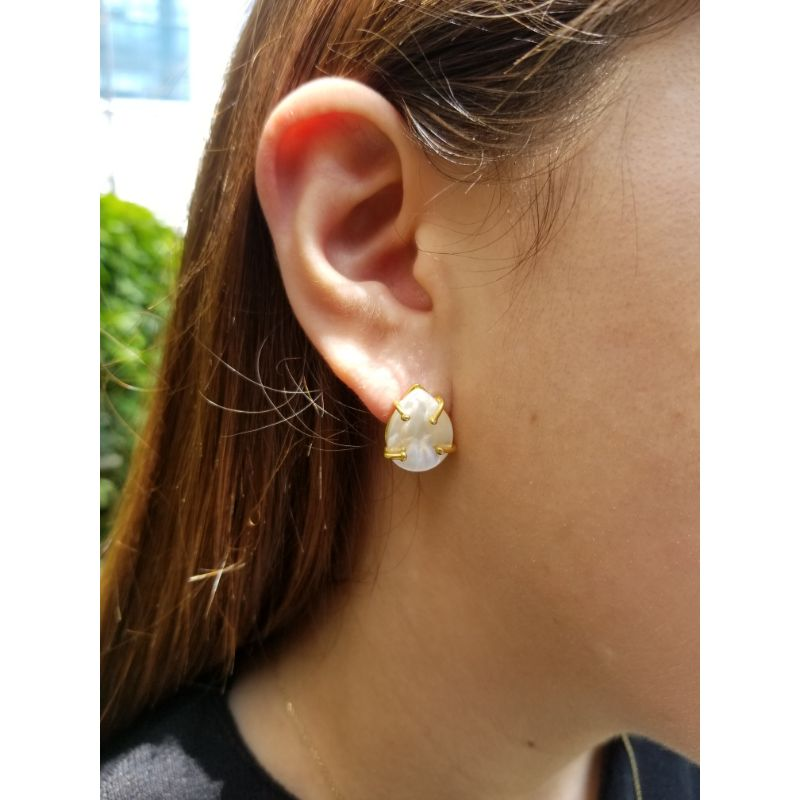 Woman with handmade mother-of-pearl earrings