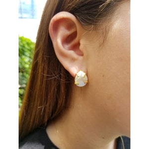 Woman with silver and mother-of-pearl earrings