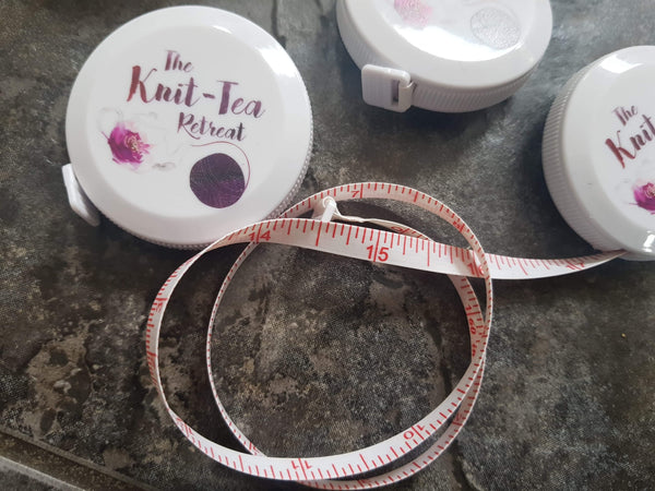 Knit-Tea Retreat branded retractable tape measure