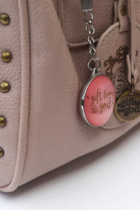 A Gift From The Gods Calligraphy Slogan Pink Keyring