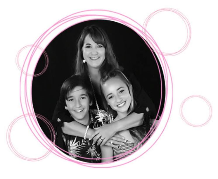 Founder Nanette and her two teen children smiling and embracing