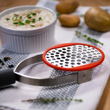 Load image into Gallery viewer, Edge Design's Potato Masher with a potato casserole