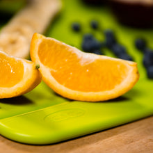 Load image into Gallery viewer, Edge Design's Green Medium Foldable Cutting Board with fruits