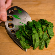 Load image into Gallery viewer, Edge Design's Herb Stripper's wide blade scrapes chopped herbs and leaves