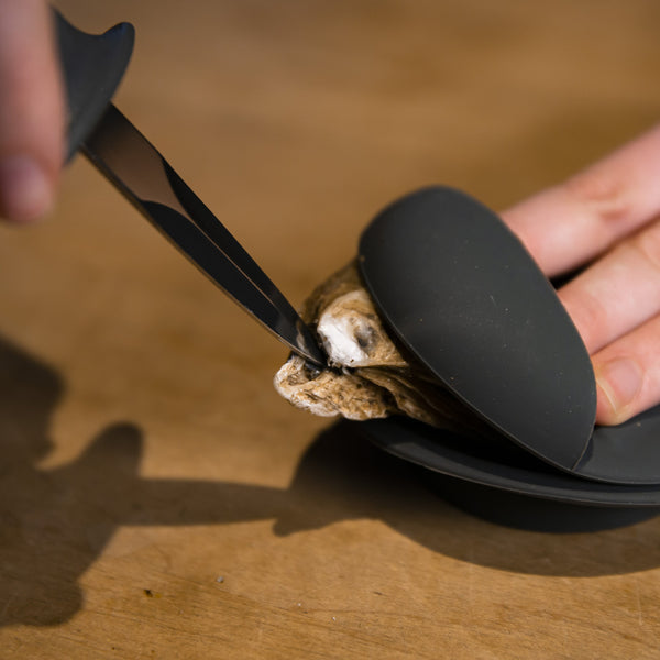 Edge Design's knife cracking open an oyster shell
