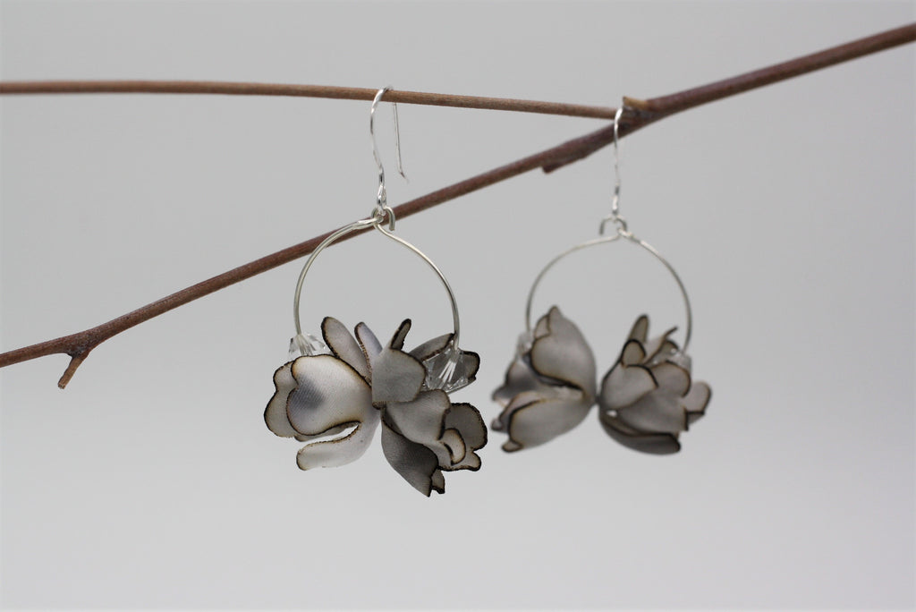Silver buds on hoops with cyrstals