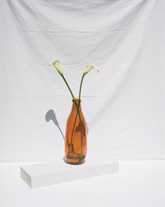 tall glass vase in amber