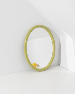 green oval wall mirror