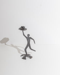 figurative candle holder