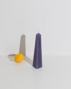purple obelisk candle