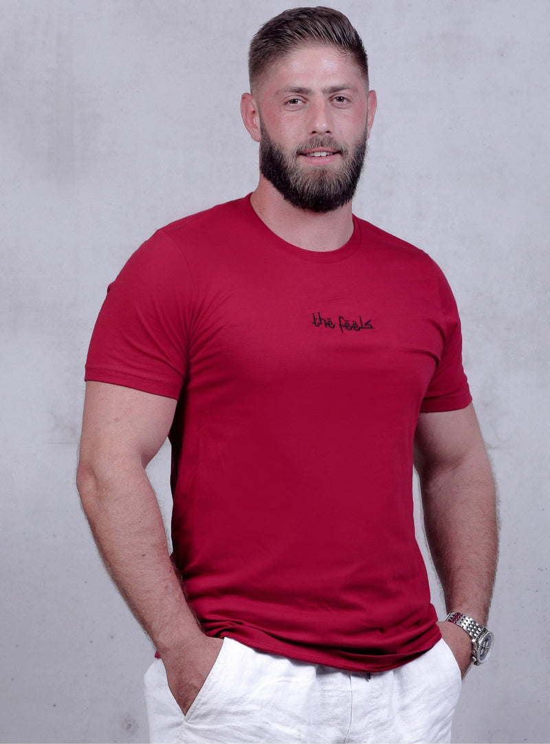 bearded muscle guy posing wearing Premium Cardinal Arabic Script T-shirt with arabic script embroidered