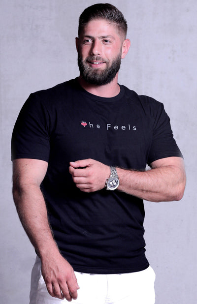 Handsome muscle guy modelling wearing Mens Short Sleeve Casual T-shirt in black showing off his muscles