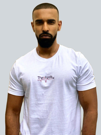 Drake look a like modelling wearing a white tight Supreme Unisex Heartbeat T-shirt showing off his muscles
