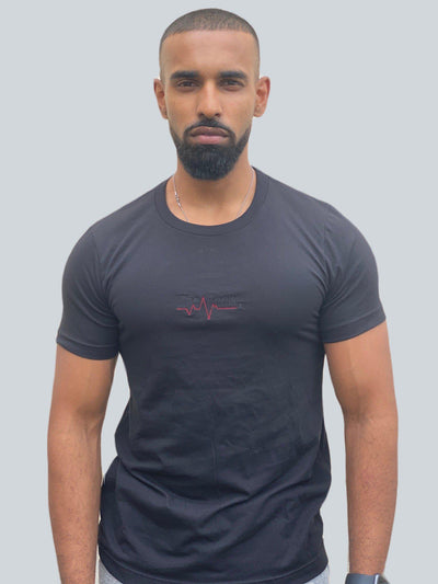 Drake look a like modelling wearing a black tight Supreme Unisex Heartbeat T-shirt showing off his muscles