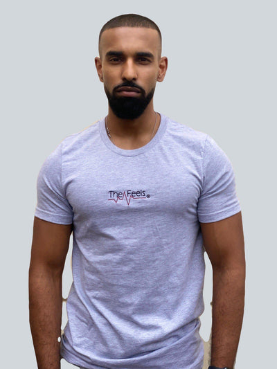 Drake look a like modelling wearing a grey tight Supreme Unisex Heartbeat T-shirt showing off his muscles