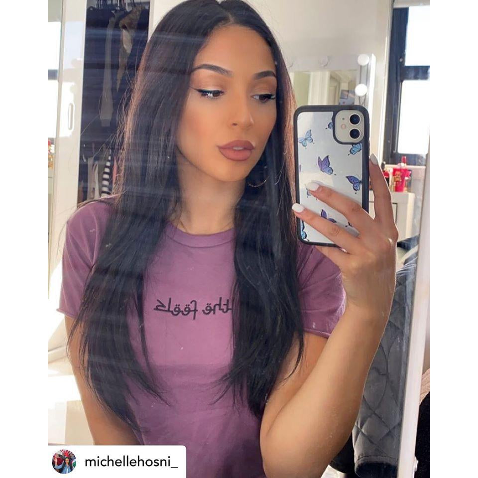 Instagram famous Michelle Hosni taking a selfie wearing the Plum Arabic Script Crop in her room