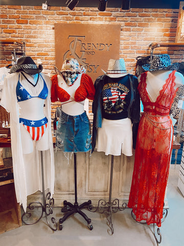 Four mannequins in trendy summer outfits