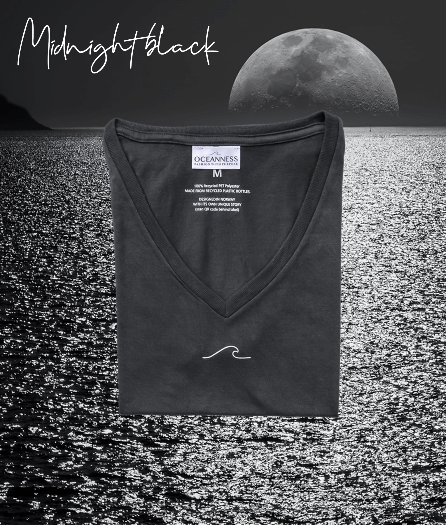 Midnight Black women's Oceanness t-shirt in front of moon and ocean by night