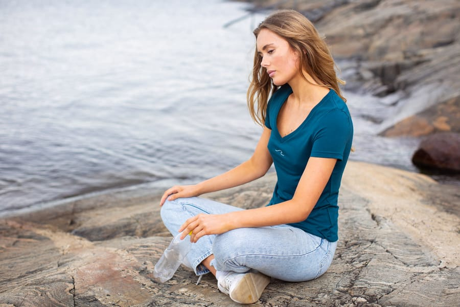 Woman in Oceanness eco-friendly t-shirt made from recycled plastic bottles