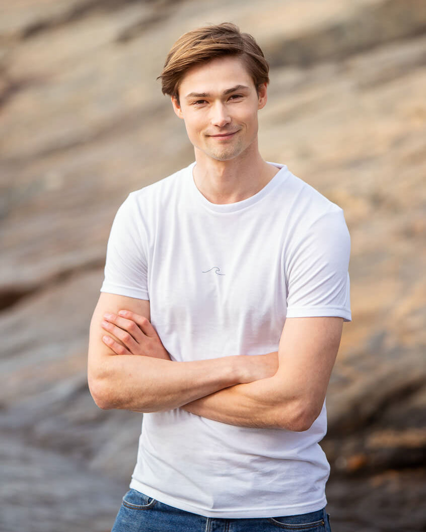 Model posing in Men's Eco Oceanness T-shirt in Arctic White