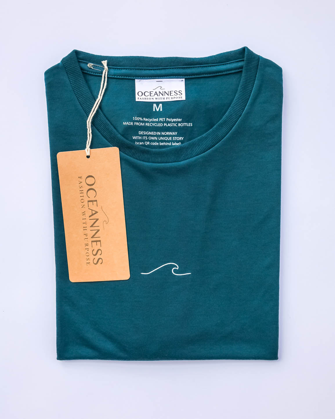 Model posing in Men's Eco Oceanness T-shirt in Ocean Green