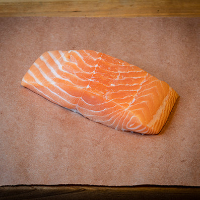 6oz uncooked salmon filet on butcher paper.
