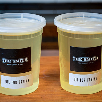 Two quart containers of oil for frying.