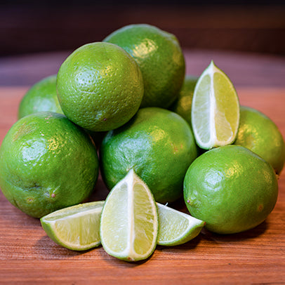 Eight limes, one of which is quartered.