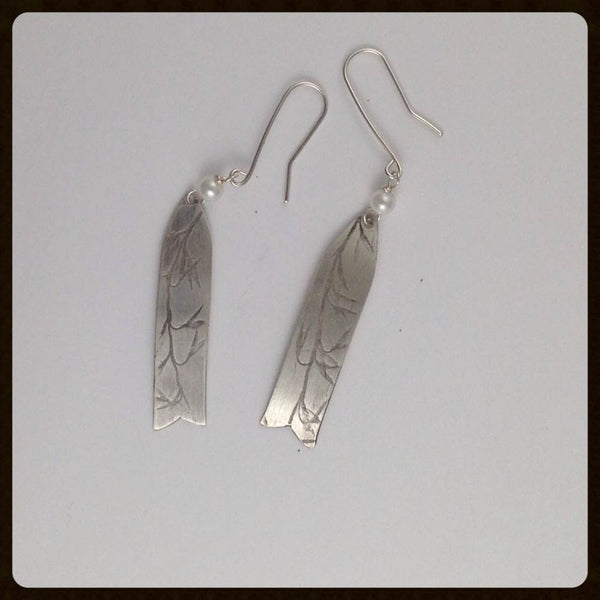 Silver plant imprint earrings