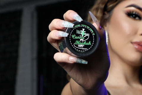 beautiful girl standing with a bottle of green care solutions brand cbd canah hookah