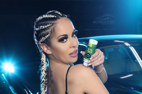 beautiful girl standing with a bottle of green care solutions brand cbd roll on product