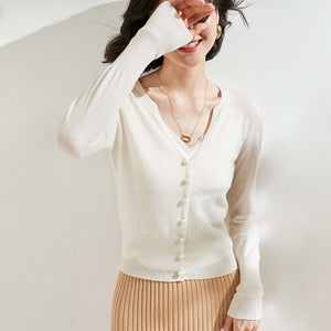 Small White Pearl Buttoned Merino Wool Sweater