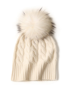 Cable beanie with fox fur pom