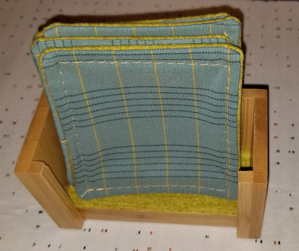 Bamboo coaster holder with turquoise and lime plaid coaster.