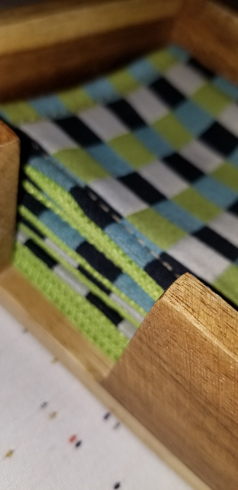 Chuck black, white, lime green, and turquoise gingham check patterned coasters in modern square bamboo coaster holder Caroline, detail.