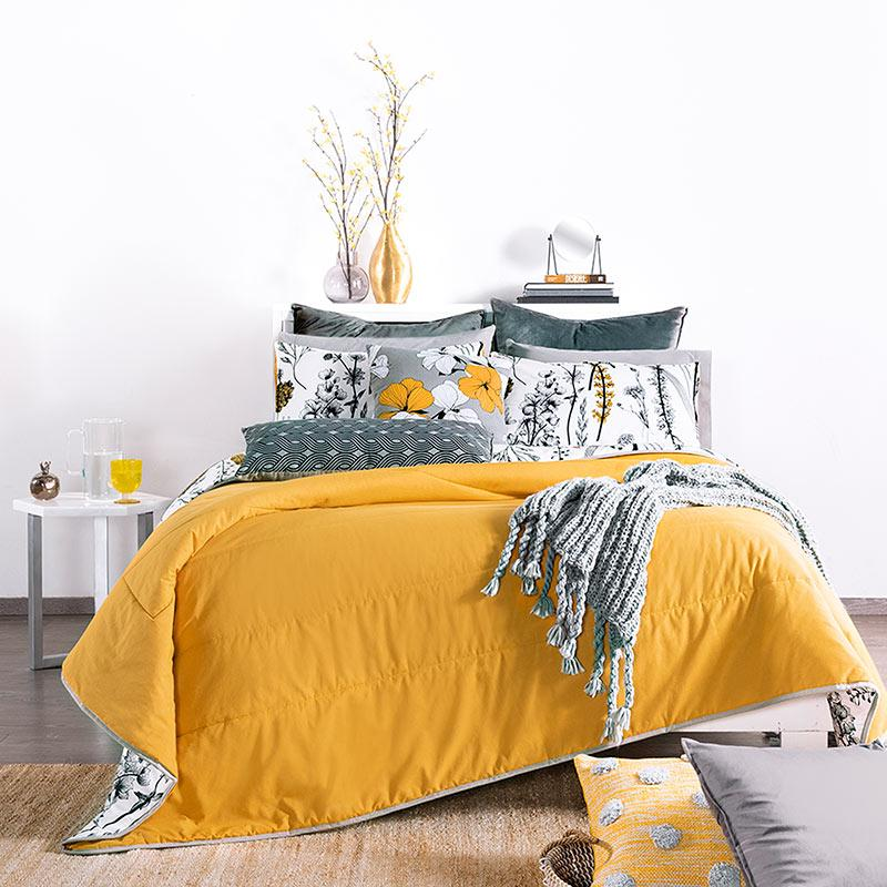 modern home bedroom decor with yellow, black, & white floral reversible comforter set front view