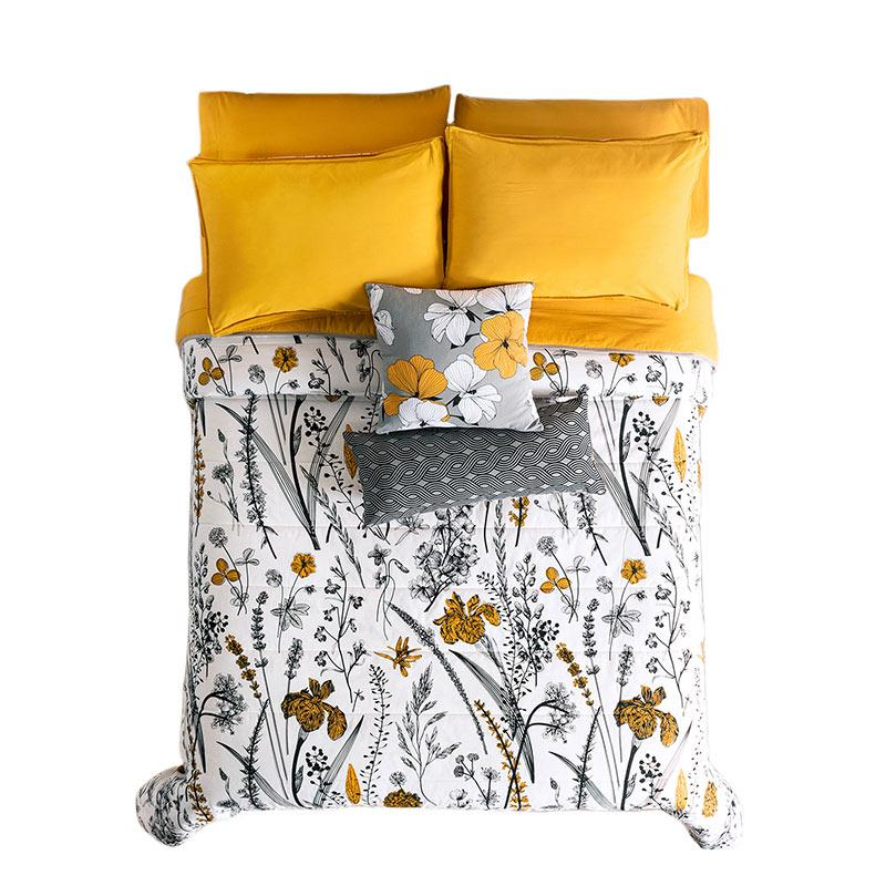 Yellow Dahlia modern bedding with yellow, black, & white floral reversible comforter set top view