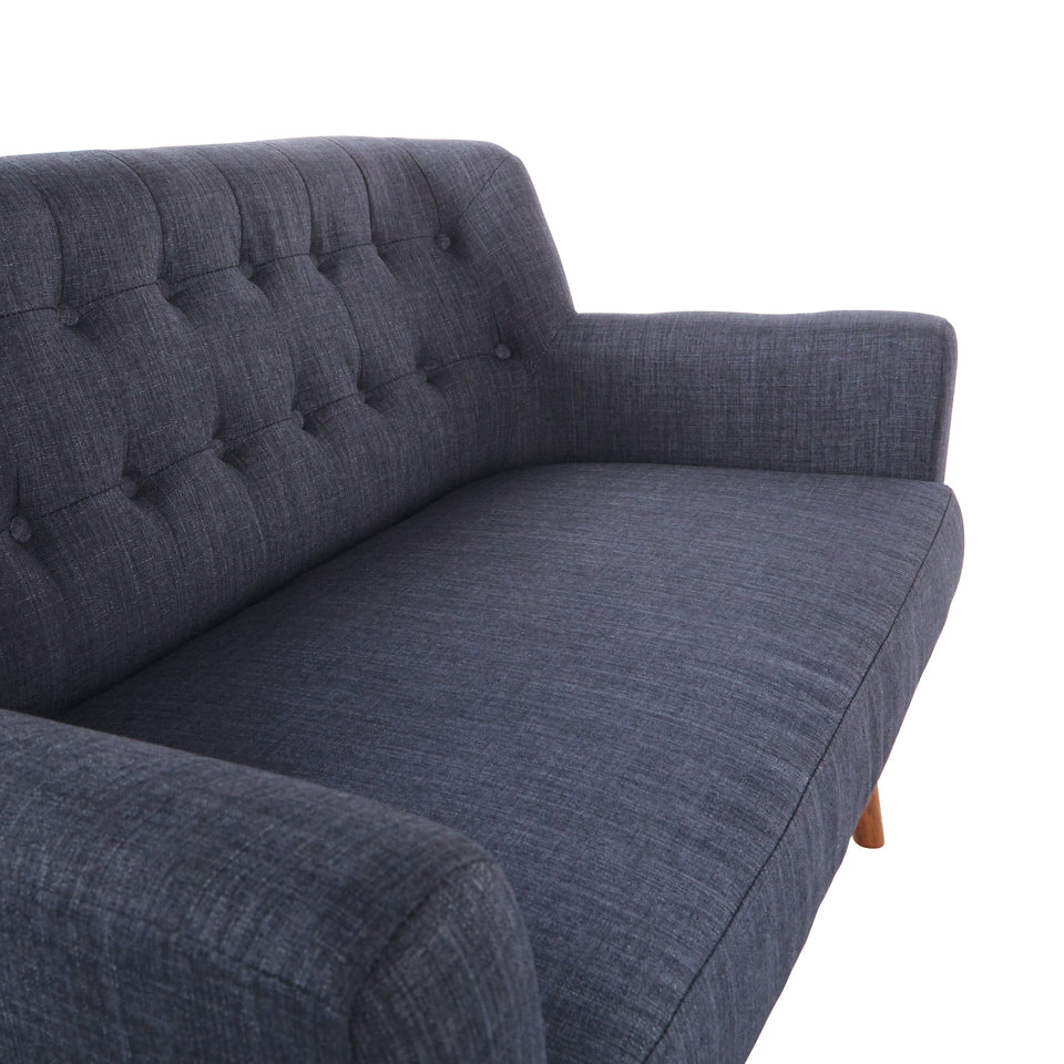 Milstein mid century modern tufted blue loveseat with cherry legs front angle detail view