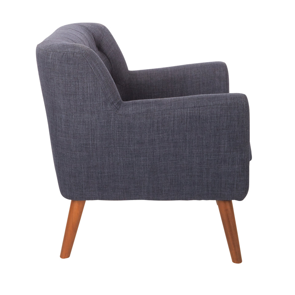 Milstein mid century modern tufted blue lounge chair with cherry legs side view
